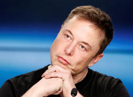 FILE PHOTO: Elon Musk at a press conference following the first launch of a SpaceX Falcon Heavy rocket in Cape Canaveral