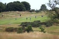 A general view of social distancing on the fairway during day one of the British Masters at Close House Golf Club, near Newcastle, England, Wednesday July 22, 2020. The European Tour resumes in earnest after its pandemic-induced shutdown with the British Masters starting Wednesday. (Mike Egerton/PA via AP)