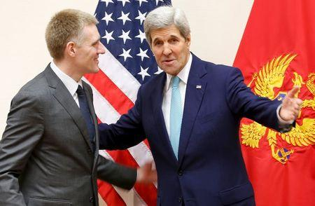 U.S. Secretary of State John Kerry (R) meets Montenegro's Foreign Minister Igor Luksic at the NATO ministerial meetings at NATO Headquarters in Brussels December 2, 2015. REUTERS/Jonathan Ernst