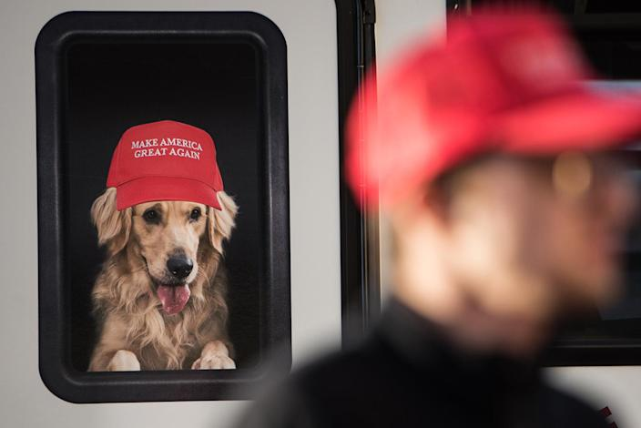 <p>A man stands near a Donald Trump campaign vehicle with an image of a dog in a window before a campaign rally February 5, 2016 in Florence, South Carolina. (Sean Rayford/Getty Images) </p>