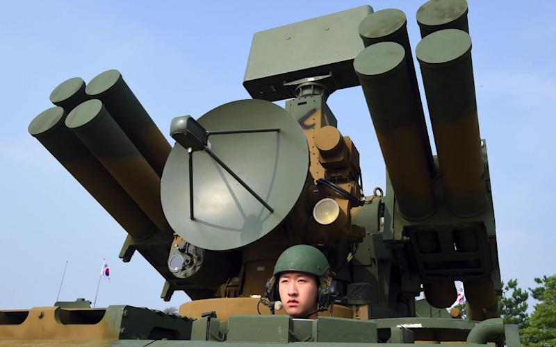 A South Korean soldier sitting on a Chunma self-propelled short range air defense missile system - AFP