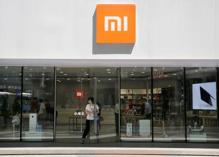 FILE PHOTO: A customer walks out of a Xiaomi store in Beijing, China June 21, 2018. REUTERS/Jason Lee/File Photo