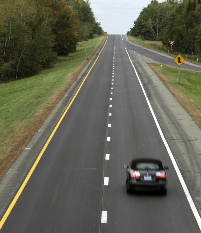 A car cruises northbound on I-95 in Old Town, Maine on Wednesday, Sept. 28, 2011. Next week motorists will be permitted to drive faster when the speed limit becomes 75 mph, the fastest in New England. Maine's Transportation Department will post 75 mph speed limits from Old Town to Houlton. (AP Photo/Pat Wellenbach)