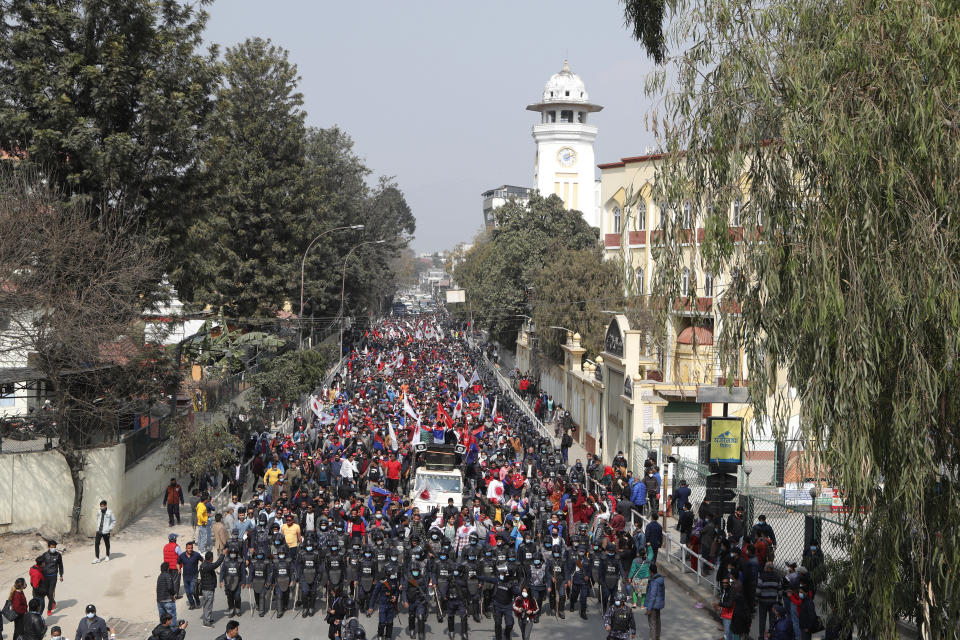 Nepalese supporters of a splinter group in the governing Nepal Communist Party participate in a rally to celebrate the Supreme Court order in Kathmandu, Nepal, Wednesday, Feb. 24, 2021. Nepal's Supreme Court on Tuesday ordered the reinstatement of Parliament after it was dissolved by the prime minister, in a ruling likely to thrust the Himalayan nation into a political crisis. (AP Photo/Niranjan Shrestha)