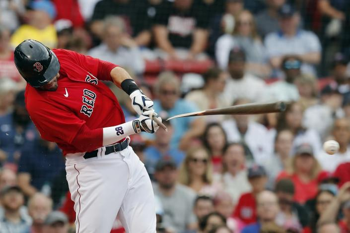 Boston Red Sox's J.D. Martinez breaks his bat as he grounds into a double play during the fifth inning of a baseball game against the Philadelphia Phillies, Saturday, July 10, 2021, in Boston. (AP Photo/Michael Dwyer)