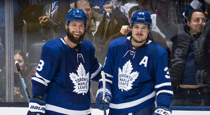 TORONTO, ON - OCTOBER 25: Auston Matthews #34 of the Toronto Maple Leafs celebrates his goal against the San Jose Sharks with teammate Jake Muzzin #8 during the third period at the Scotiabank Arena on October 25, 2019 in Toronto, Ontario, Canada. (Photo by Mark Blinch/NHLI via Getty Images)