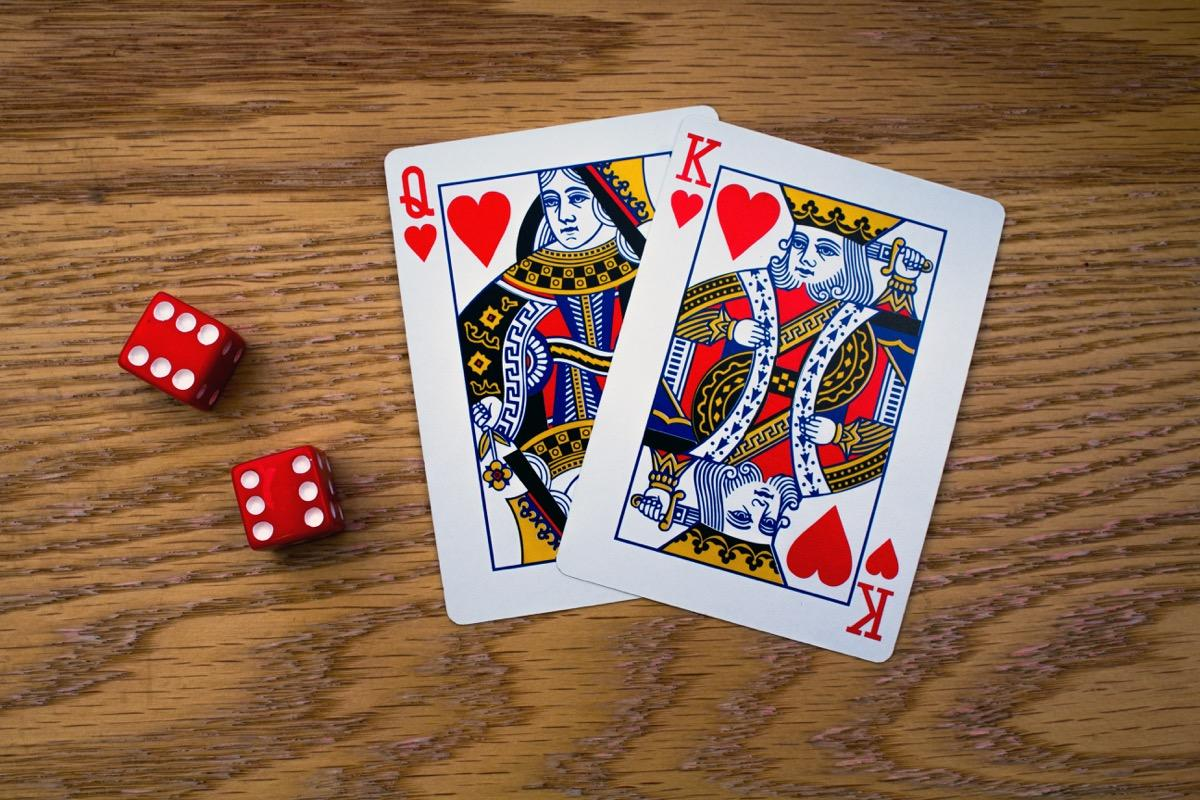 """There are four kings in every deck of cards. And while they all look similar, the king of hearts is the only royal fellow who doesn't have a mustache. According to <a href=""""https://www.theguardian.com/lifeandstyle/2008/nov/22/card-games-facts"""" target=""""_blank""""><em>The Guardian</em></a>, the so-called """"suicide king"""" (who earned his name because it looks like he's stabbing himself in the head with a sword), wasn't always bare-faced. He mistakenly lost his facial hair in a redesign."""