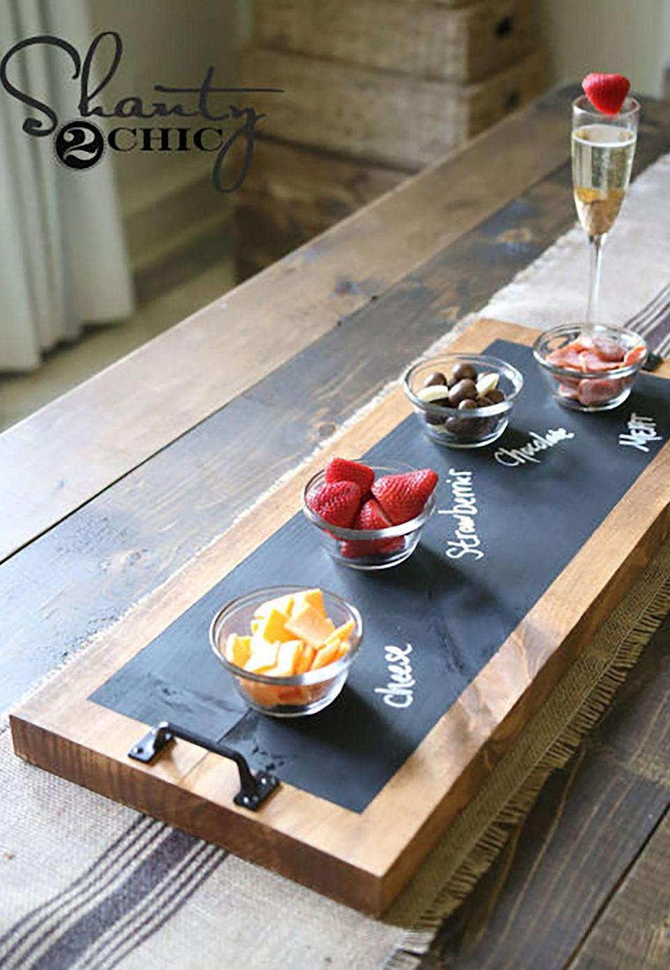 """<p>Let the ladies of Shanty2Chic walk you through a tutorial for this easy-to-make chalkboard serving tray,the perfect gift for a friend who is always entertaining.</p><p><strong>Get the tutorial at <a href=""""http://www.shanty-2-chic.com/2016/08/diy-chalkboard-serving-tray-tutorial-youtube-video.html"""" rel=""""nofollow noopener"""" target=""""_blank"""" data-ylk=""""slk:Shanty2Chic"""" class=""""link rapid-noclick-resp"""">Shanty2Chic</a>.</strong></p><p><strong><a class=""""link rapid-noclick-resp"""" href=""""https://go.redirectingat.com?id=74968X1596630&url=https%3A%2F%2Fwww.homedepot.com%2Fb%2FLumber-Composites-Framing-Lumber-Studs%2F12%2FN-5yc1vZc3tcZ1z0ywx1&sref=https%3A%2F%2Fwww.countryliving.com%2Fdiy-crafts%2Ftips%2Fg645%2Fcrafty-christmas-presents-ideas%2F"""" rel=""""nofollow noopener"""" target=""""_blank"""" data-ylk=""""slk:SHOP BOARDS"""">SHOP BOARDS</a><br></strong></p>"""
