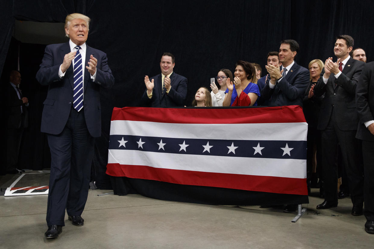 President-elect Donald Trump at a Wisconsin rally in December 2016. Among the welcomers are House Speaker Paul Ryan, R-Wis., right, and Gov. Scott Walker, R-Wis., second from right. (Photo: Evan Vucci/AP)