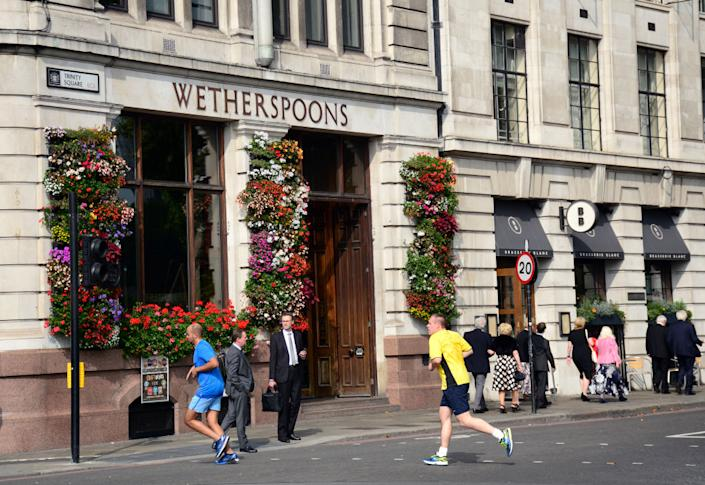 Wetherspoons is a popular chain of pubs across the U.K. (Image via Getty Images)