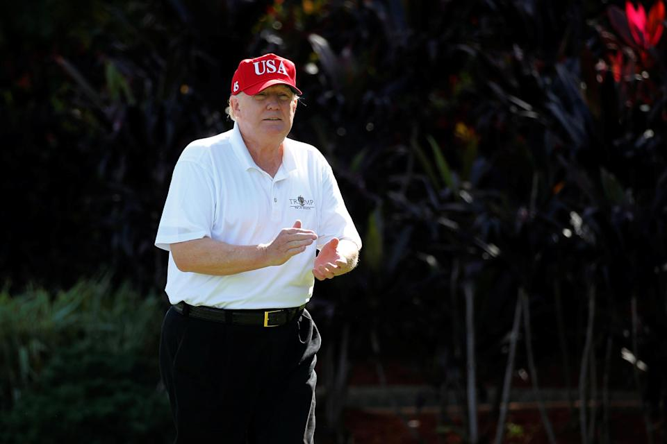 President Trump arrives to play host to members of the U.S. Coast Guard he invited to play golf at his Trump International Golf Club in West Palm Beach, Fla.. (Photo: Jonathan Ernst/Reuters)