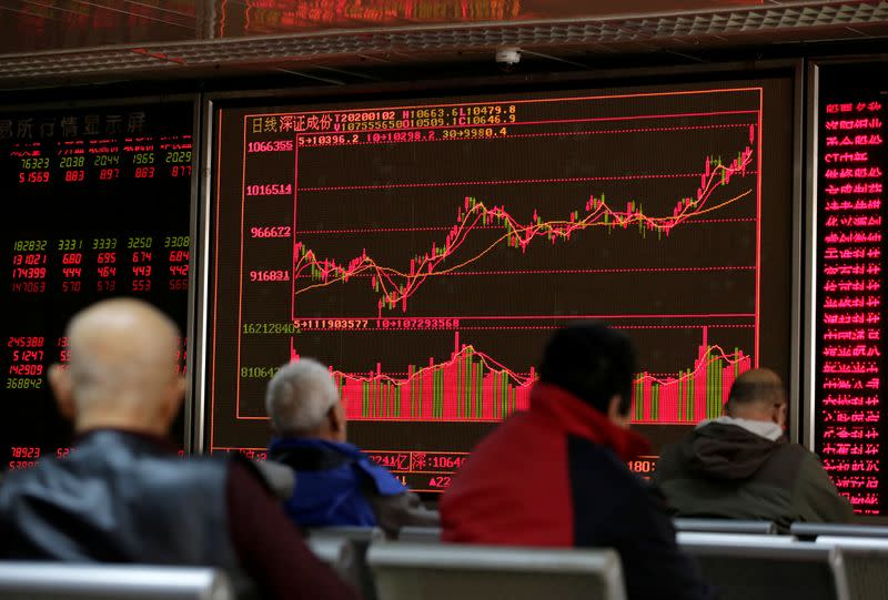 A board shows stock information at a brokerage office in Beijing