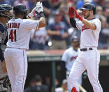 Cleveland Indians' Mike Freeman, right, is congratulated by Carlos Santana after hitting a 2-run home run off New York Yankees relief pitcher Tommy Kahnle in the sixth inning of a baseball game, Sunday, June 9, 2019, in Cleveland. (AP Photo/David Dermer)