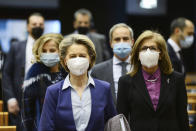 European Commission President Ursula von der Leyen, center left, and European Health Commissioner Stella Kyriakides, second right, arrives for a debate on the united EU approach to COVID-19 vaccinations at the European Parliament in Brussels, Wednesday, Feb. 10, 2021. (Johanna Geron, Pool via AP)