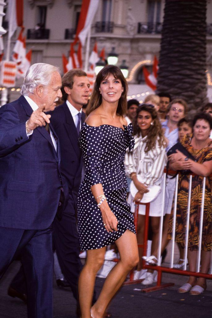 <p>A polka dot-clad princess, accompanied by her father and her husband (Casiraghi) in 1988. </p>