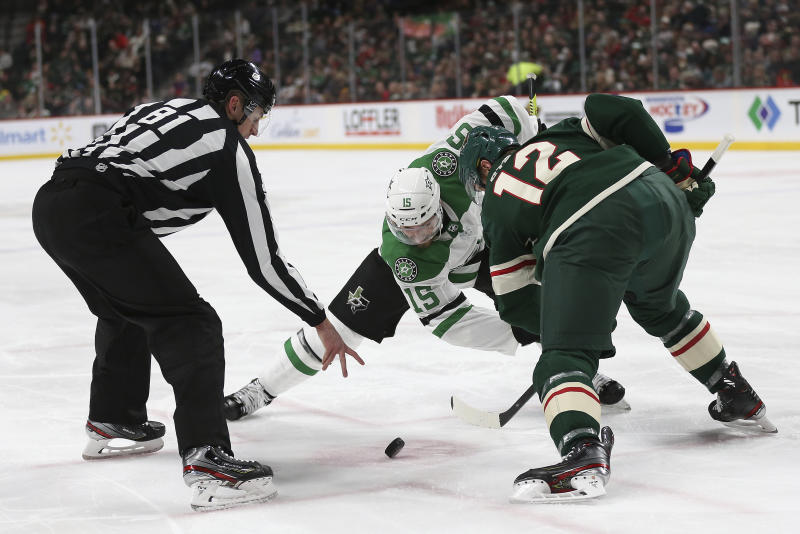 Minnesota Wild's Eric Staal, right, and Dallas Stars' Blake Comeau, center, face off in the second period of an NHL hockey game Saturday, Jan. 18, 2020, in St. Paul, Minn. (AP Photo/Stacy Bengs)