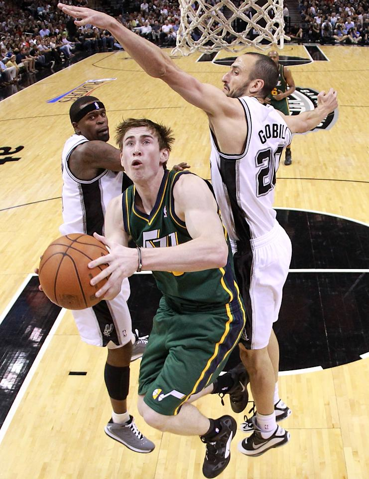 SAN ANTONIO, TX - MAY 02:  Gordon Hayward #20 of the Utah Jazz takes a shot against Manu Ginobili #20 of the San Antonio Spurs in Game Two of the Western Conference Quarterfinals of the 2012 NBA Playoffs at AT&T Center on May 2, 2012 in San Antonio, Texas.  NOTE TO USER: User expressly acknowledges and agrees that, by downloading and or using this photograph, User is consenting to the terms and conditions of the Getty Images License Agreement.  (Photo by Ronald Martinez/Getty Images)