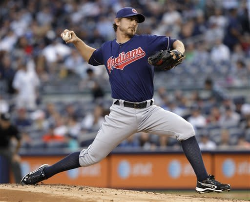 Cleveland Indians starting pitcher Josh Tomlin delivers in the first inning against the New York Yankees during a baseball game at Yankee Stadium in New York, Monday, June 25, 2012. (AP Photo/Kathy Willens)