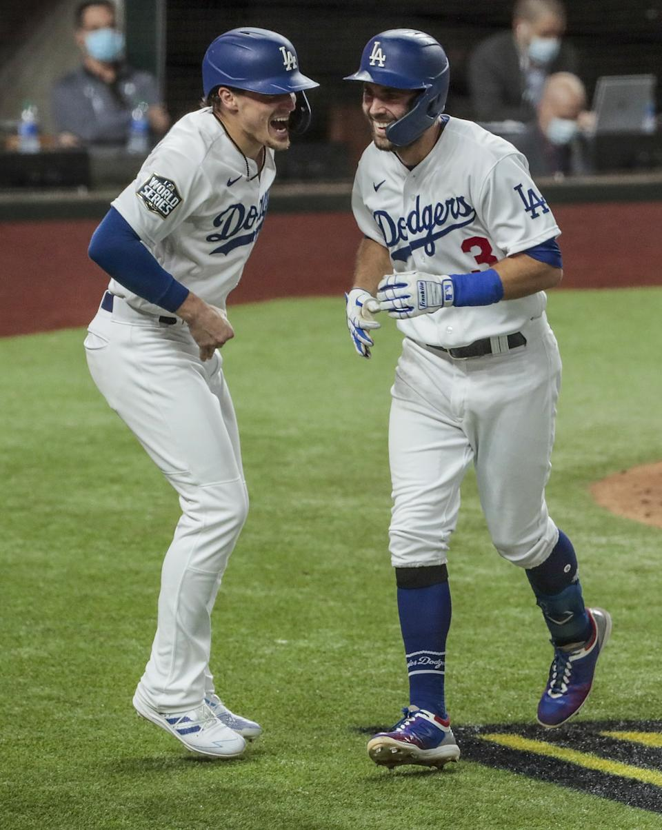 Dodgers second baseman Chris Taylor homers in the fifth inning and gets an earful from second baseman Kike Hernandez.