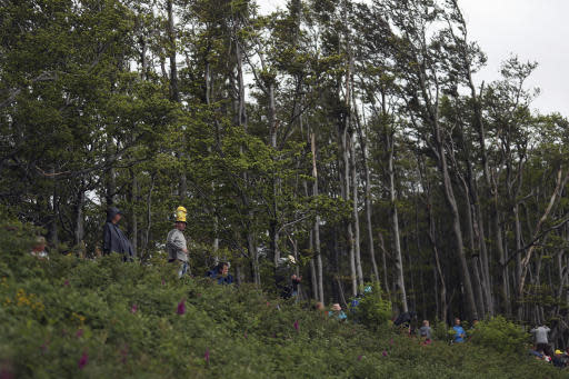 Spectators stand next to the finish line of the sixth stage of the Tour de France cycling race over 160 kilometers (100 miles) with start in Mulhouse and finish in La Planche des Belles Filles, France, Thursday, July 11, 2019. (AP Photo/Thibault Camus)