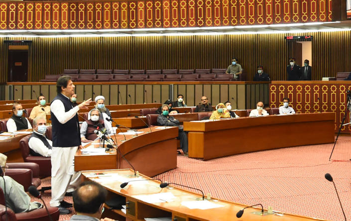 """In this photo released by the Press Information Department, Pakistani Prime Minister addresses the Parliament in Islamabad, Pakistan, Thursday, June 25, 2020. Khan accused the United States on Thursday of having """"martyred"""" al-Qaida leader and the mastermind of the 9/11 attacks, Osama bin Laden. (Press Information Department, via AP)"""