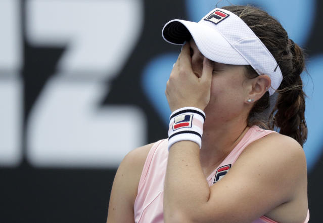 Australia's Kimberly Birrell reacts during her second round match against Croatia's Donna Vekic at the Australian Open tennis championships in Melbourne, Australia, Wednesday, Jan. 16, 2019. (AP Photo/Aaron Favila)