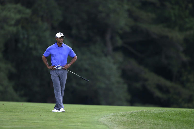 Tiger Woods waits to hit on the 10th hole during the first round of the U.S. Open golf tournament at Merion Golf Club, Thursday, June 13, 2013, in Ardmore, Pa. (AP Photo/Darron Cummings)