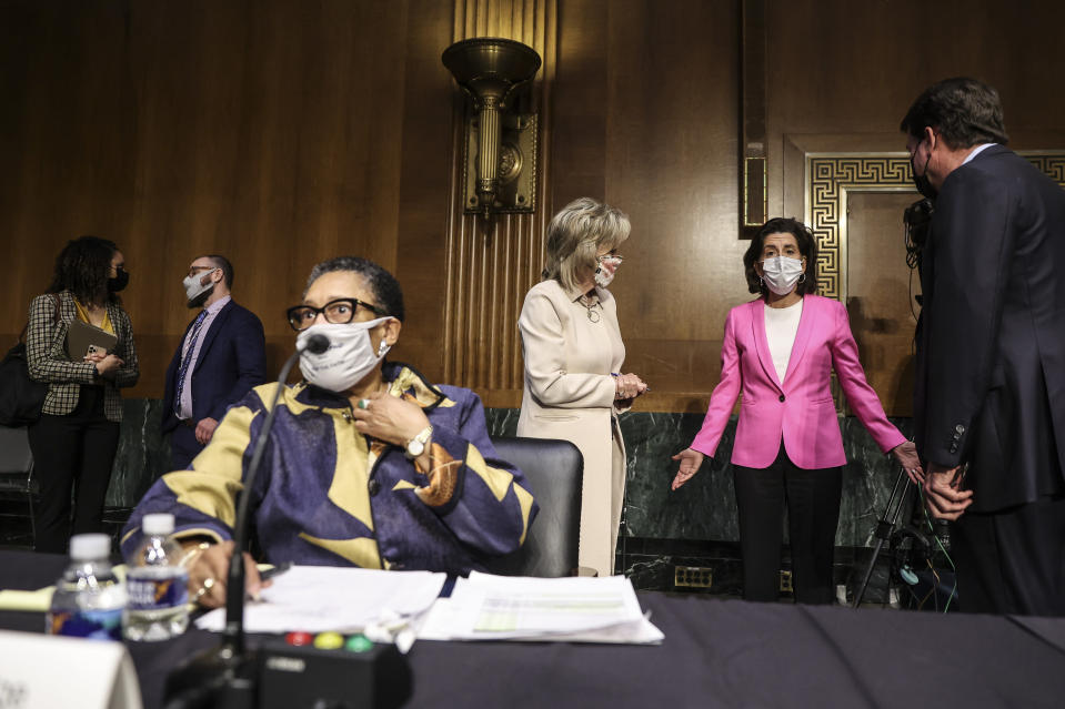 Commerce Secretary Gina Raimondo, second right, speaks with, Sen. Cindy Hyde-Smith, R-Miss., and Sen. Bill Hagerty, R-Tenn., right, as Housing and Urban Development Secretary Marcia Fudge, left, arrives for a Senate Appropriations Committee hearing on Capitol Hill, Tuesday, April 20, 2021 in Washington. (Oliver Contreras/The Washington Post via AP, Pool)