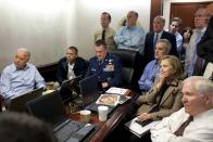 In this image released by the White House and digitally altered by the source to diffuse the paper in front of Secretary of State Hillary Rodham Clinton, President Barack Obama and Vice President Joe Biden, along with with members of the national security team, receive an update on the mission against Osama bin Laden in the Situation Room of the White House, Sunday, May 1, 2011, in Washington. (Pete Souza/The White House via AP)