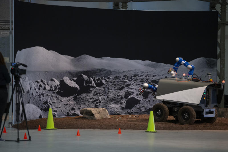 The Space Rover picks up a rock during a training exercise of the European Space Agency, ESA, in Katwijk, near The Hague, Netherlands, Monday, Nov. 25, 2019. (AP Photo/Peter Dejong)