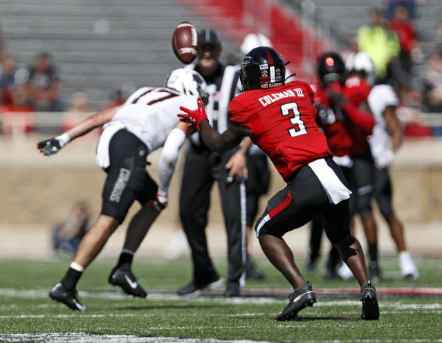 Texas Tech's Douglas Coleman III (3) intercepts a pass intended for Oklahoma State's Dillon Stoner (17) during the second half of an NCAA college football game against Texas Tech, Saturday, Oct. 5, 2019, in Lubbock, Texas. (AP Photo/Brad Tollefson)