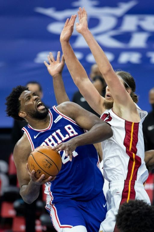 Philadelphia's Joel Embiid controls the ball against Miami's Kelly Olynyk in the 76ers' 137-134 NBA overtime win over the Heat