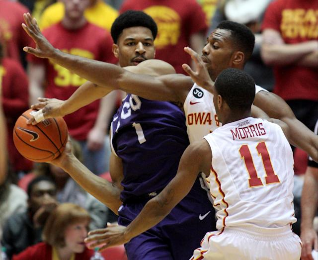 Iowa State forward Melvin Ejim (3) and Iowa State guard Monte Morris (11) defend TCU center Karviar Shepherd (1) during the first half of an NCAA college basketball game at Hilton Coliseum in Ames, Iowa, Saturday, Feb. 8, 2014. (AP Photo/Justin Hayworth)