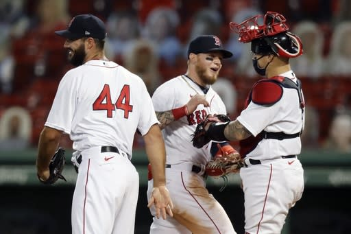 Boston Red Sox's Alex Verdugo, center, celebrates with Brandon Workman (44) and Christian Vazquez after the Red Sox defeated the Toronto Blue Jays during a baseball game, Friday, Aug. 7, 2020, in Boston. (AP Photo/Michael Dwyer)