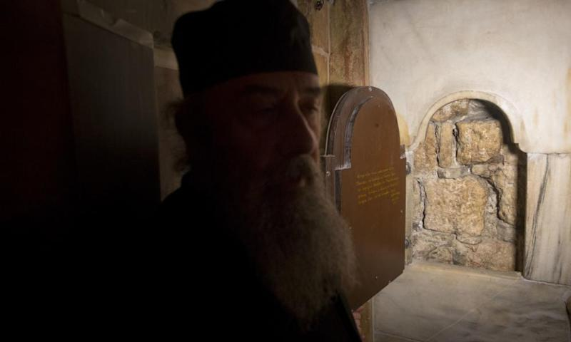 A window cut into the burial chamber of Jesus's tomb for pilgrims to see what is believed to be the original stone wall of the burial cave.