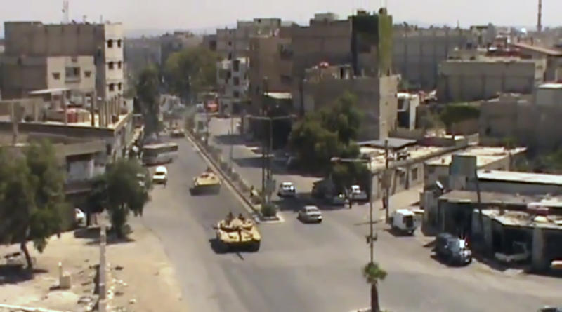 This image made from video provided by Shaam News Network Tuesday, July 17, 2012, purports to show Syrian tanks in Damascus, Syria. (AP Photo/Shaam News Network via AP video) THE ASSOCIATED PRESS HAS NO WAY OF INDEPENDENTLY VERIFYING THE CONTENT, LOCATION OR DATE OF THIS PICTURE.