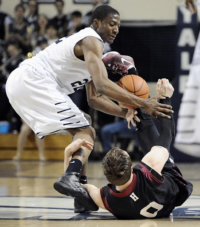 Yale's Justin Sears, left, tangles with Harvard's Laurent Rivard, right, during the first half of an NCAA college basketball game, Friday, March 7, 2014, in New Haven, Conn. (AP Photo/Jessica Hill)
