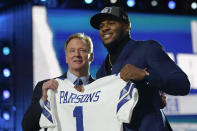 Penn State linebacker Micah Parsons, right, holds a team jersey with NFL Commissioner Roger Goodell after the was chosen by the Dallas Cowboys with the 12th pick in the NFL football draft Thursday, April 29, 2021, in Cleveland. (AP Photo/Tony Dejak)