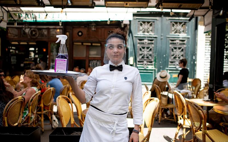 Waitresses wear PPE to serve customers