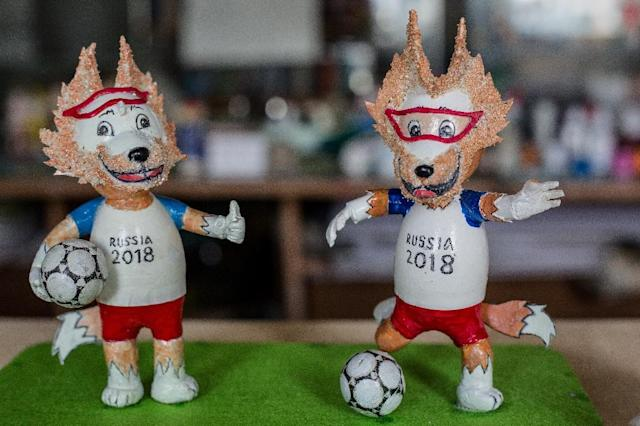 Most of the tiny statues are of tournament mascot Zabivaka, a wolf in sports goggles kicking a football (AFP Photo/Thanh NGUYEN)