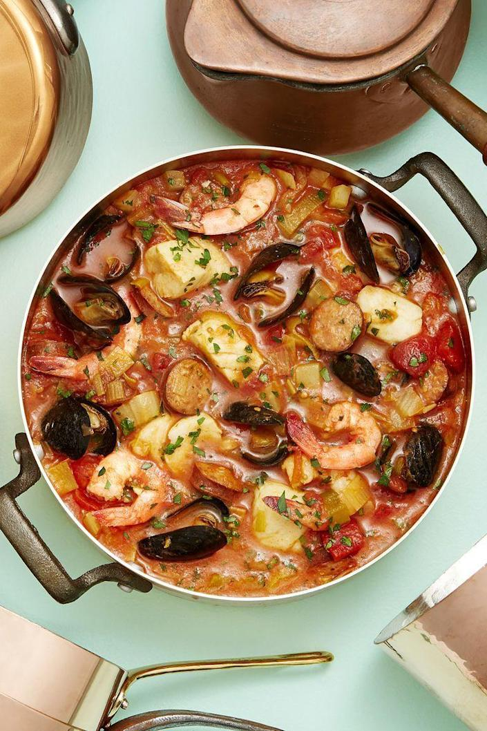 """<p>This hearty stew is loaded with andouille sausage, mussels, shrimp, and flaky white fish.</p><p><strong><a href=""""https://www.countryliving.com/food-drinks/a19705080/seafood-and-sausage-stew-recipe/"""" rel=""""nofollow noopener"""" target=""""_blank"""" data-ylk=""""slk:Get the recipe"""" class=""""link rapid-noclick-resp"""">Get the recipe</a>.</strong></p><p><strong><a class=""""link rapid-noclick-resp"""" href=""""https://www.amazon.com/Lodge-Enameled-Classic-Enamel-Basting/dp/B000N501BK?tag=syn-yahoo-20&ascsubtag=%5Bartid%7C10063.g.35055779%5Bsrc%7Cyahoo-us"""" rel=""""nofollow noopener"""" target=""""_blank"""" data-ylk=""""slk:SHOP DUTCH OVENS"""">SHOP DUTCH OVENS</a><br></strong></p>"""