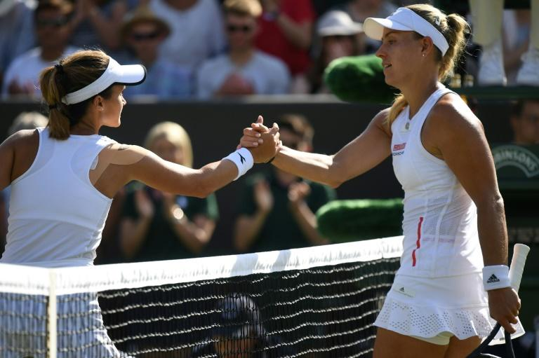 Defending Wimbledon champion Kerber stunned in second round by lucky-loser Davis