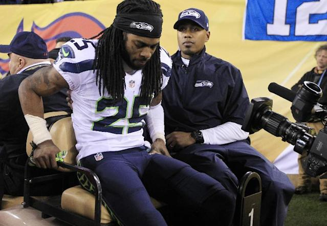 Seattle Seahawks' Richard Sherman (25) is carted off the field after getting injured during the second half of the NFL Super Bowl XLVIII football game against the Denver Broncos Sunday, Feb. 2, 2014, in East Rutherford, N.J. (AP Photo/Jeff Roberson)