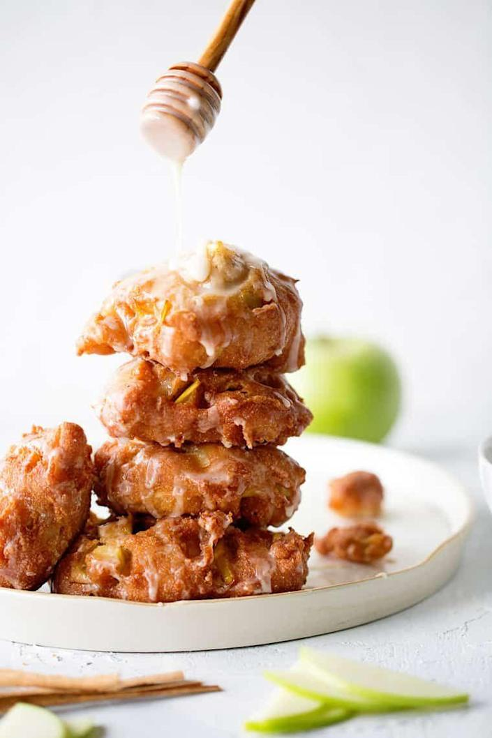 """<p>Apple pieces get wrapped in a sugary dough and fried to perfection in this easy recipe. (Just make sure the individual apple pieces are small enough to tenderize as they fry.)</p><p><strong>Get the recipe at <a href=""""https://grandbaby-cakes.com/apple-fritters/"""" rel=""""nofollow noopener"""" target=""""_blank"""" data-ylk=""""slk:Grandbaby Cakes"""" class=""""link rapid-noclick-resp"""">Grandbaby Cakes</a>.</strong></p>"""