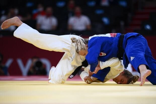 Canada's Jessica Klimkait, in blue, and Slovenia's Kaja Kajzer, in white, compete in the judo women's under-57 kg bronze medal bout during the Tokyo Olympic Games. (Franck Fife/AFP via Getty Images - image credit)