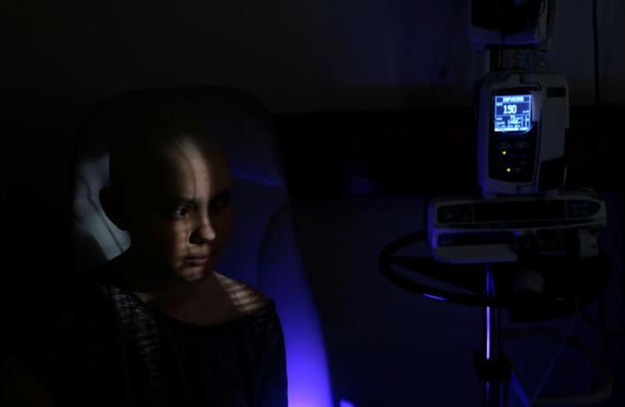 The Wider Image: The pandemic, a deadly cancer and my 14-year-old daughter