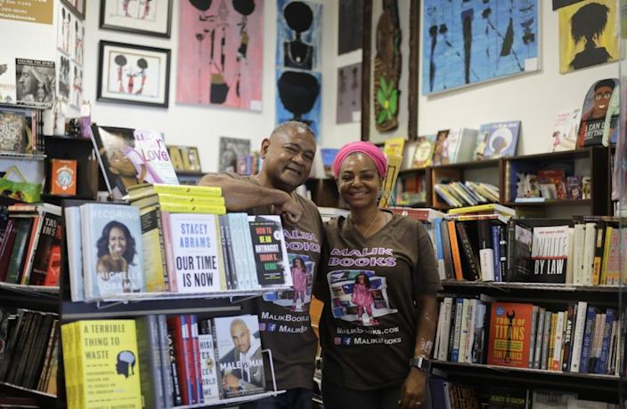 "Malik and April Muhammad of Malik Books, one of many Black-owned stores coping with increased demand as orders come in from all corners of the world. <span class=""copyright"">(Myung J. Chun/Los Angeles Times)</span>"