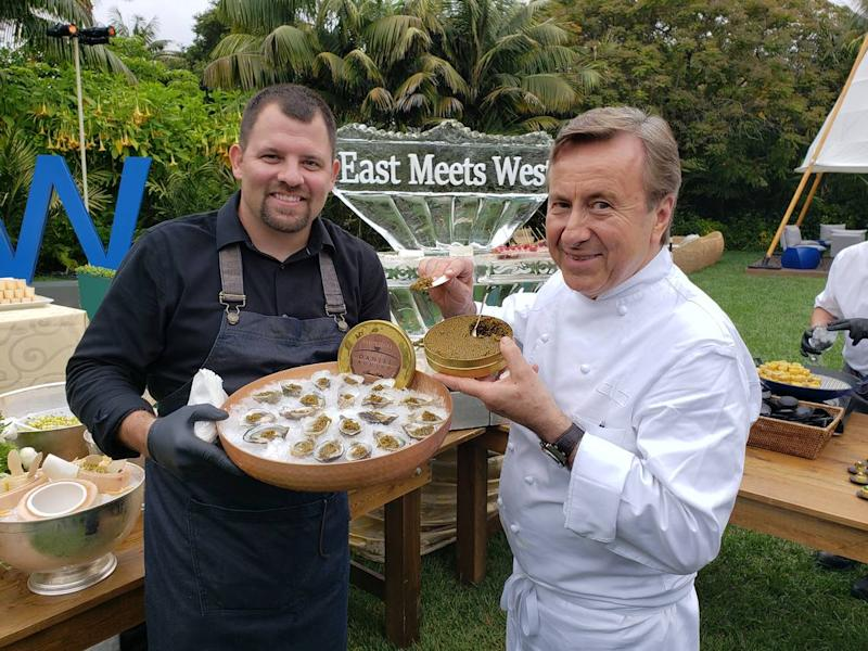 Morro Bay Oyster Co. owner Neal Maloney, left, holds oysters with Chef Daniel Boulud, right, holding caviar, during an event at the Biltmore Four Seasons in Santa Barbara.
