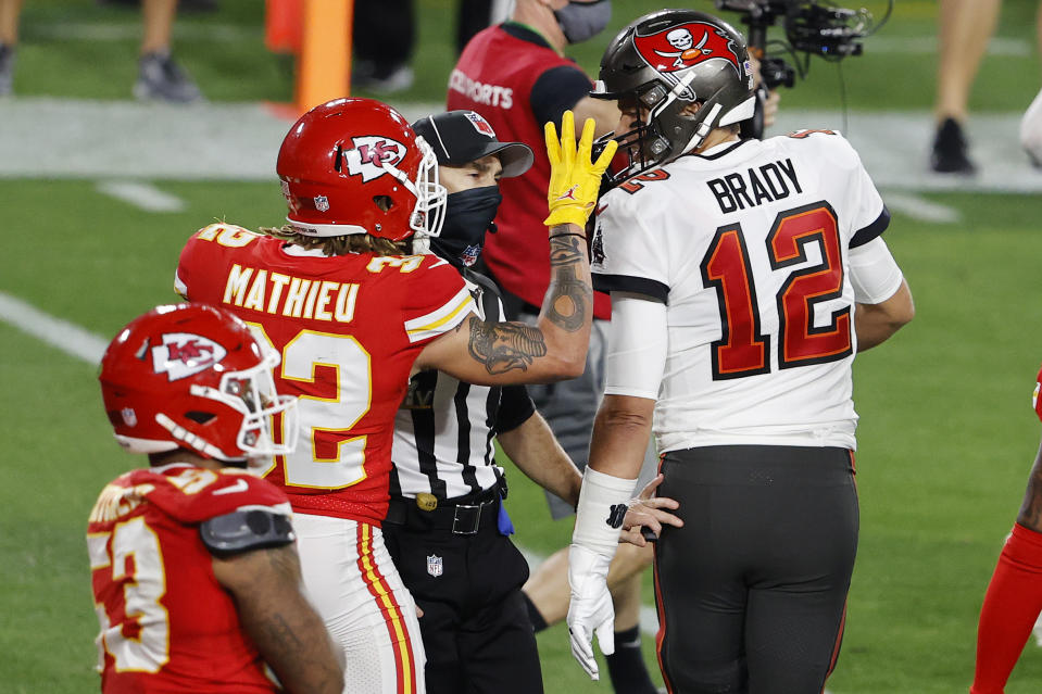 Feb 7, 2020; Tampa, FL, USA; An NFL official moves in to separate Tampa Bay Buccaneers quarterback Tom Brady (12) and Kansas City Chiefs strong safety Tyrann Mathieu (32) during the second quarter of Super Bowl LV at Raymond James Stadium.  Mandatory Credit: Kim Klement-USA TODAY Sports