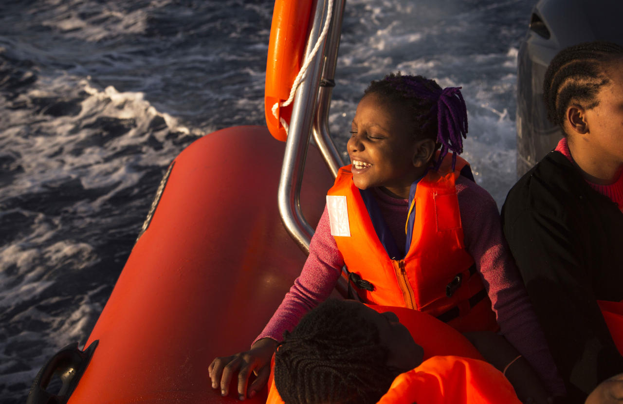 <p> Sira, 9, a migrant from Nigeria, smiles as she rides aboard a boat of the Proactiva Open Arms NGO, after being rescued during an operation in the Mediterranean sea, about 17 miles north of Sabratah, Libya, Saturday, Aug. 20, 2016. (AP Photo/Emilio Morenatti) </p>